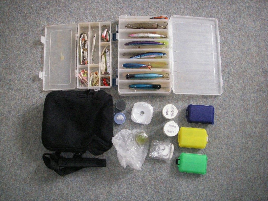 Lure and fly boxes, black bum bag and odds and sods containers.  The poly bag contains a bouncy ball float and a trace with a couple of small plastic eels.