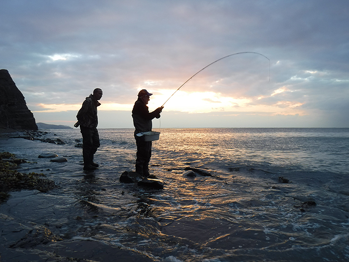Nigel play's a spirited fish on the fly rod